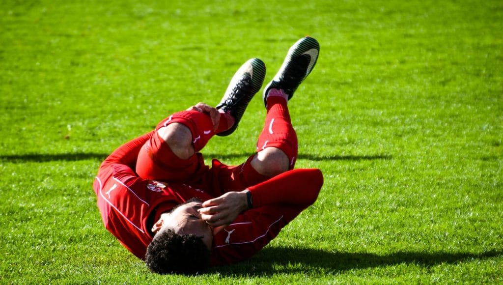 Sports injury in soccer player who is on the field.