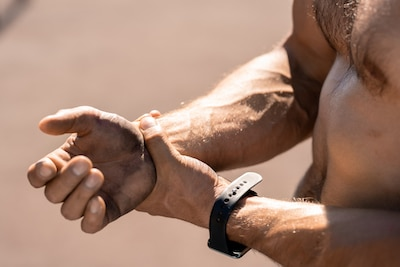 man holding his wrist due to pain