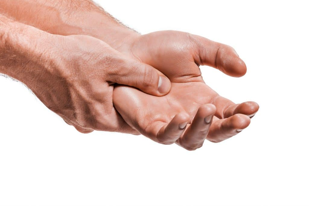 photo of a males hands with arthritis pain