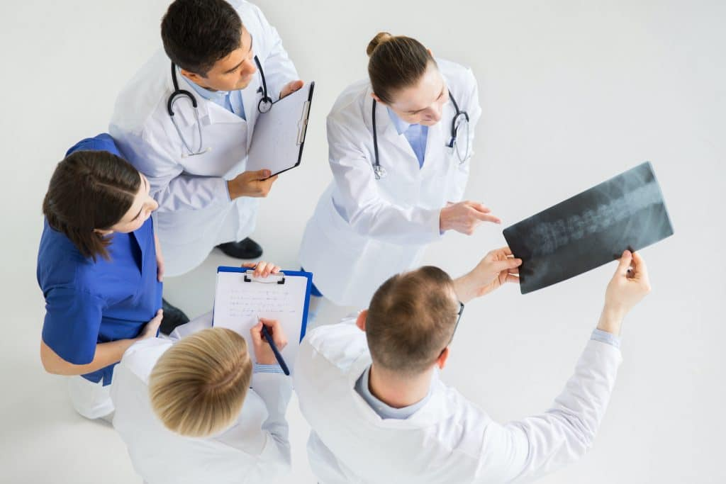 Group of doctors looking at patients records.