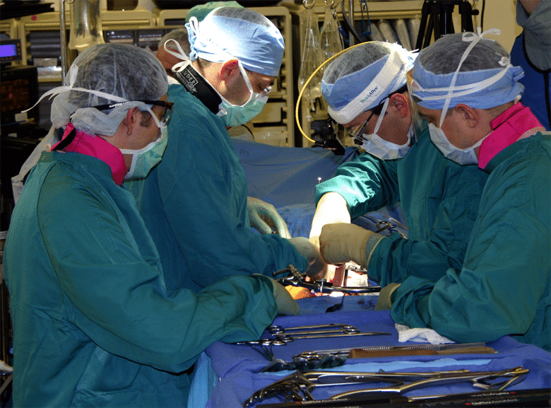 Group of orthopedic surgeons in an operating room