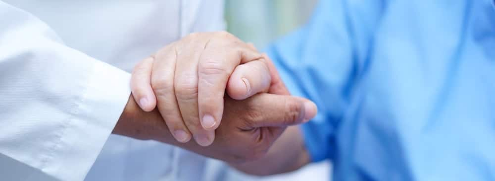 patient and doctor holding hands after regenerative medicine treatment